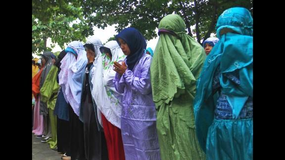 Students attend a prayer July 18 in Central Java, Indonesia. Their teacher John Paulissen was a passenger on Flight 17.