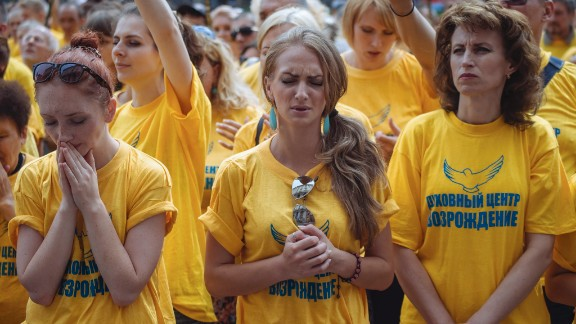 People in Kiev gather to mourn the victims on July 18.