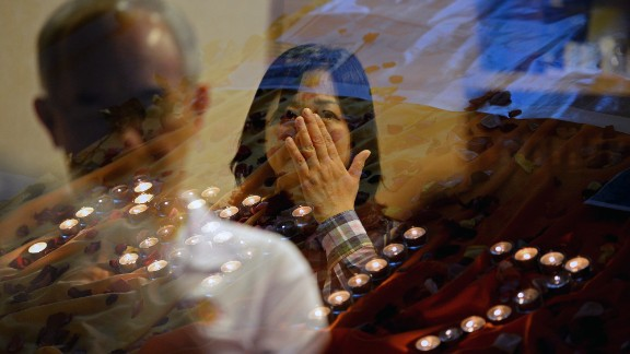 People pray for the victims of Malaysia Airlines Flight 17 at a church outside Kuala Lumpur on July 18.