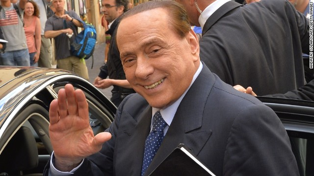 Caption:Italian former Prime Minister Silvio Berlusconi waves as he leaves after a press conference on June 18, 2014 in Rome. AFP PHOTO / ANDREAS SOLARO (Photo credit should read ANDREAS SOLARO/AFP/Getty Images)