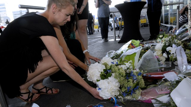 People lay flowers and light candles in front of the Schiphol airport on July 18, 2014, a day after a Malaysian Airlines flight MH17 carrying 298 people from Amsterdam to Kuala Lumpur crashed in eastern Ukraine. Global demands mounted Friday to find those responsible for apparently shooting down th plane over rebel-held eastern Ukraine as relatives around the world mourned the deaths of the on board. AFP PHOTO/JOHN THYS        (Photo credit should read JOHN THYS/AFP/Getty Images)