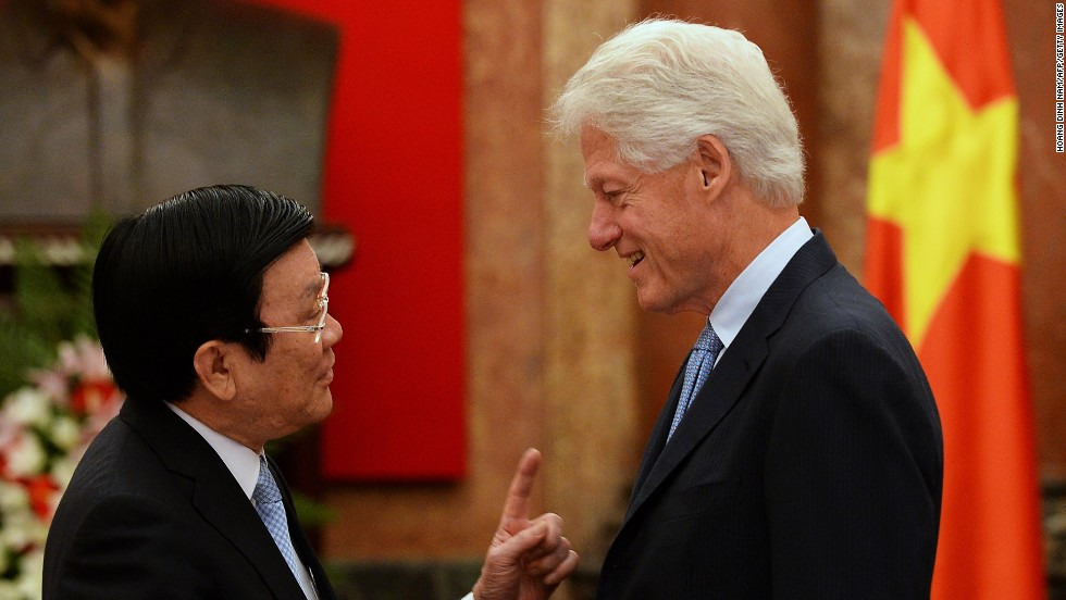 Clinton shakes hands with Vietnam's President Truong Tan Sang at the presidential palace in Hanoi on July 18. It has been 20 years since President Clinton lifted the U.S. trade embargo on Vietnam.
