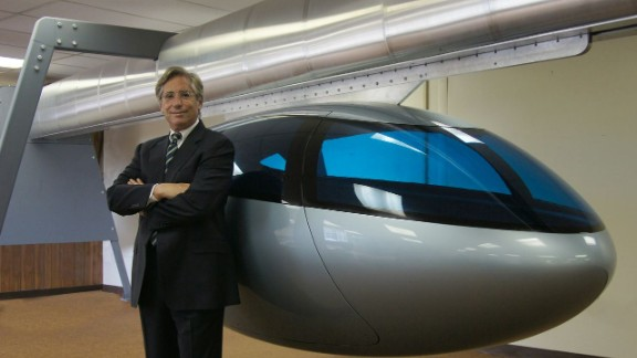 "SkyTran CEO Jerry Sanders with a model pod. ""Being stuck in traffic is just the most stress-inducing, soul-crushing part of society today,"" says Sanders. ""We really want to make people"