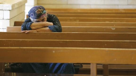 An Iraqi Christian prays at the Saint George church on July 1 in Erbil.