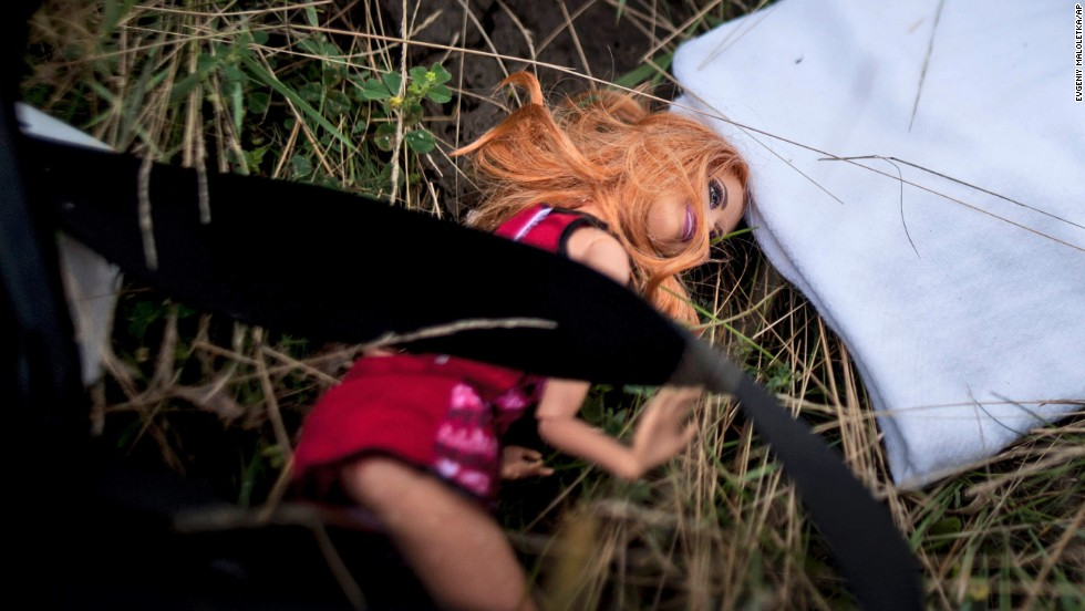 A doll is seen on the ground on Saturday, July 19.