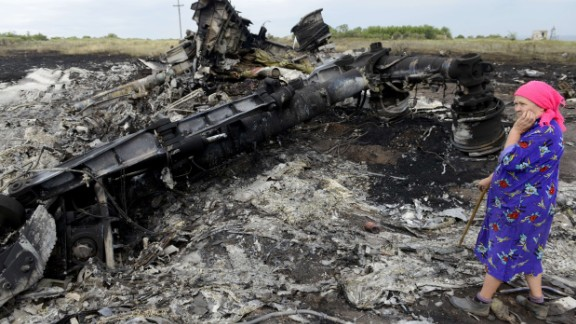A local resident stands among the wreckage at the site of the crash of a Malaysia Airlines plane carrying 298 people from Amsterdam to Kuala Lumpur in Grabove, in rebel-held east Ukraine, on July 19, 2014. Ukraine and pro-Russian insurgents agreed on July 19 to set up a security zone around the crash site of a Malaysian jet whose downing in the rebel-held east has drawn global condemnation of the Kremlin. Outraged world leaders have demanded Russia