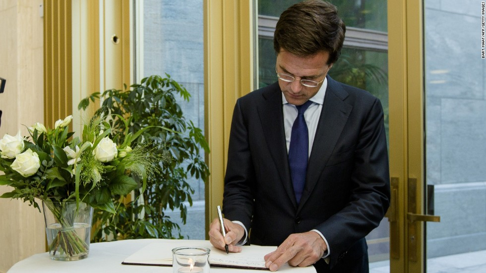 "Dutch Prime Minister Mark Rutte signs a condolence register at the Ministry of Safety and Justice in The Hague, Netherlands, on Friday, July 18. ""I want to see results in the form of unimpeded access and rapid recovery,"" Rutte said in a press briefing. ""This is now priority number one."""