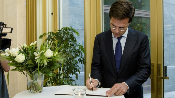 """Dutch Prime Minister Mark Rutte signs a condolence register at the Ministry of Safety and Justice in The Hague, Netherlands, on Friday, July 18. """"I want to see results in the form of unimpeded access and rapid recovery,"""" Rutte said in a press briefing. """"This is now priority number one."""""""