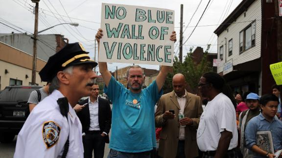 People participate in a demonstration against the death of Eric Garner after he was taken into police custody in Staten Island.