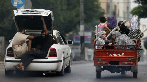 Palestinians flee their homes as Israeli troops focus their firepower on the Gaza town of Shaja