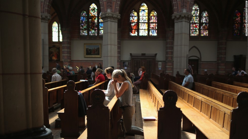 People pray during a special Mass in memory of the victims of Malaysia Airlines Flight 17 on July 20 in St. Vitus Church in Hilversum, Netherlands. The United States says a surface-to-air missile took down the Boeing 777 in eastern Ukraine on July 17 as it was flying from Amsterdam, Netherlands, to Kuala Lumpur, Malaysia, killing all 298 people aboard. At least 192 of the dead were Dutch.