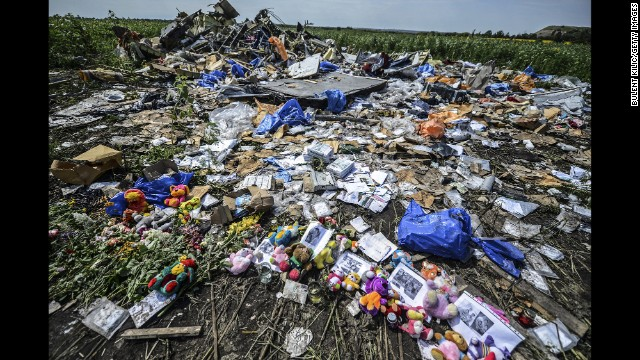 Flowers, soft toys along with pictures are left amongst the wreckage at the site of the crash of  on July 20, 2014.