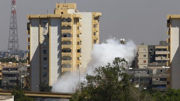 Smoke billows near Tripoli international airport  as militias continued to battle for control on July 20, 2014.
