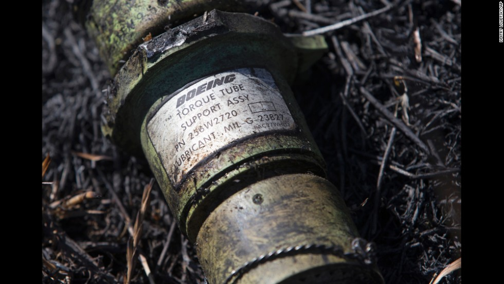 A piece of the plane lies in the grass in eastern Ukraine's Donetsk region on July 21, 2014.