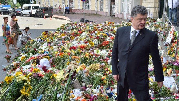 Ukrainian President Petro Poroshenko attends a flower-laying ceremony at the Dutch Embassy in Kiev, Ukraine, on July 21. Although the passengers came from all over the world, many of them were Dutch because the flight originated in Amsterdam.