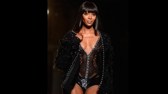 Model Naomi Campbell wows the crowd during the Versace show at Paris Fashion Week in 2013.