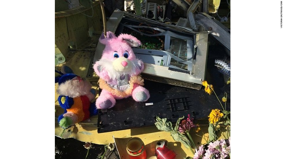 Makeshift memorial with candles, stuffed toys and other items in honor of the deceased.