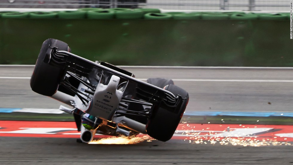 Formula One driver Felipe Massa crashes Sunday, July 20, during the opening lap of the German Grand Prix in Hockenheim, Germany. Massa wasn't hurt in the crash, which occurred after his car was clipped from behind.