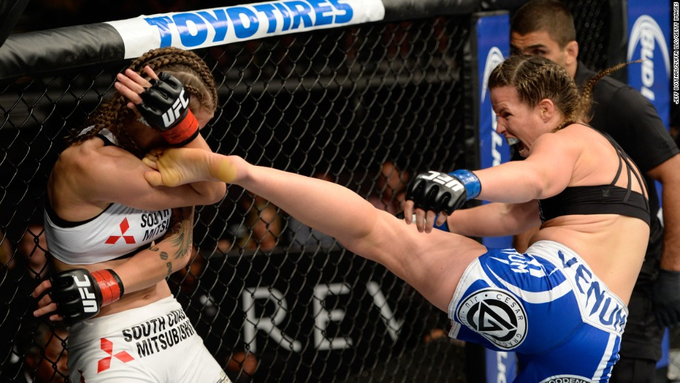 Leslie Smith kicks Jessamyn Duke in their UFC bantamweight bout Wednesday, July 16, in Atlantic City, New Jersey. Smith won by a first-round technical knockout.