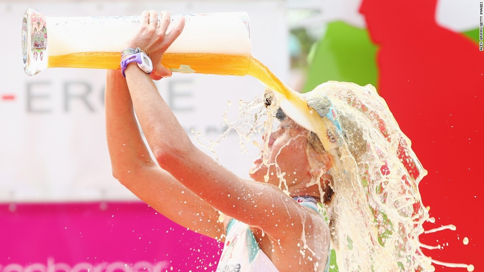 Mirinda Carfrae of Australia celebrates with a beer after winning the Challenge Roth, a triathlon in Roth, Germany, on Sunday, July 20.