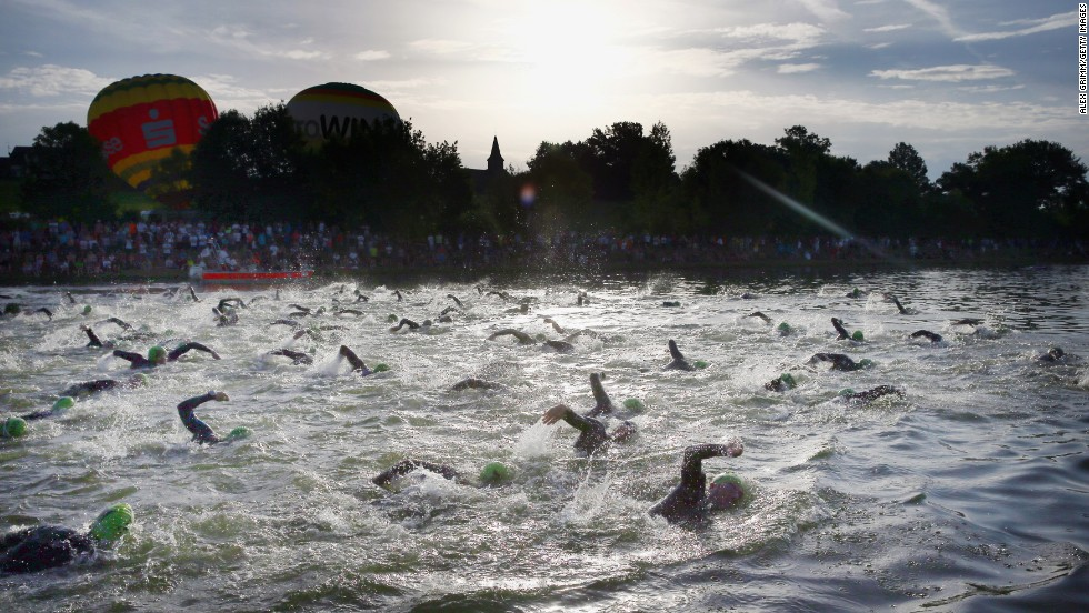 Participants compete in the swimming portion of the Challenge Roth triathlon Sunday, July 20, in Roth, Germany.