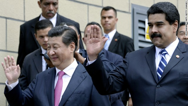 Venezuelan President Nicolas Maduro (R) and China's President Xi Jinping (L), wave in Caracas on July 21, 2014. Xi hopes to deepen ties with Venezuela just as its ties with the United States -- the region's traditional political and economic powerhouse -- are at a low point. Later Monday Xi heads to Cuba --the last stop of his tour-- where he is to announce plans to build a factory producing 'biosensors' for monitoring the blood of diabetics and other patients suffering from chronic illness, Cuban media reported. AFP PHOTO/LEO RAMIREZ (Photo credit should read LEO RAMIREZ/AFP/Getty Images)