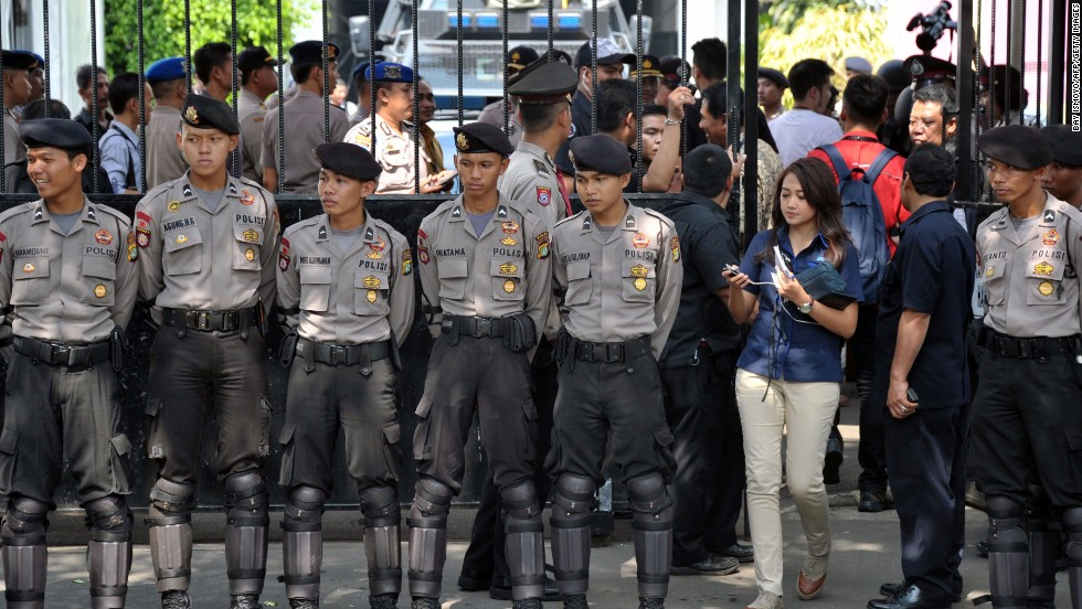 Indonesian police secure the area around the General Elections Commission building in Jakarta on prior to the election count announcement. The presidential election was held July 9.