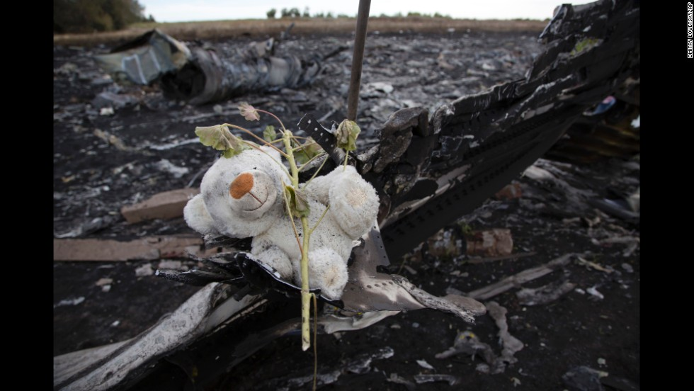 A flower and stuffed animal sit near the crash site on Monday, July 21.