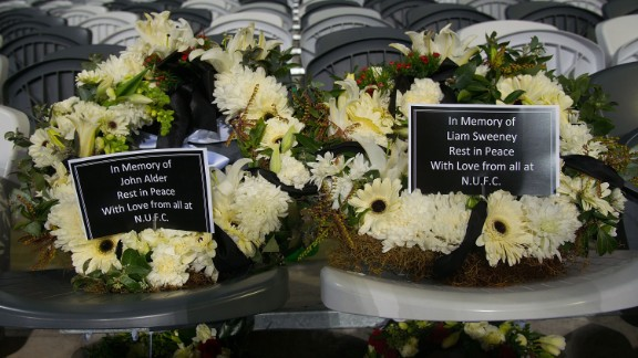 In memory of two Newcastle United fans who died in the crash, two wreaths are placed on seats July 22 at the Forsyth Barr Stadium in Dunedin, New Zealand. The soccer fans were traveling to New Zealand to watch their team play in a preseason tournament.
