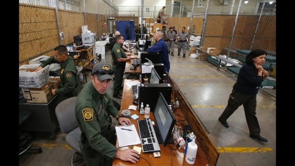 Officers in Nogales wait for new arrivals in the area where hundreds of mostly Central American immigrant children were being processed and held on Wednesday, June 18.