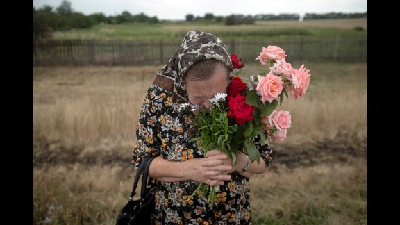 A woman cries July 22 during a service near the crash site.