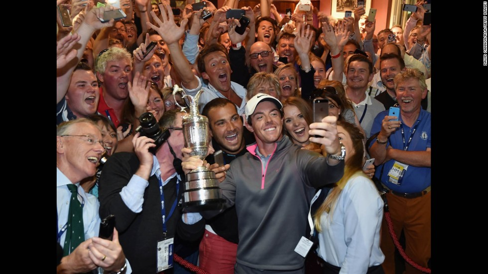 "Golfer Rory McIlroy takes a selfie with the Claret Jug and members of the Royal Liverpool Golf Club after he won the British Open on Sunday, July 20. It was the third major victory of McIlroy's career, and he only needs to win the Masters now to complete the career ""Grand Slam."""
