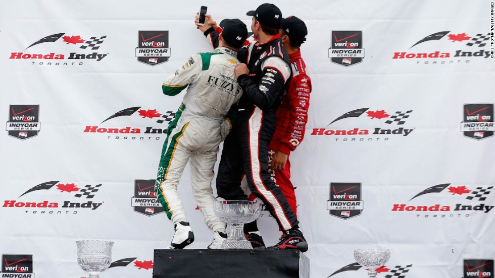 From left, IndyCar drivers Mike Conway, Will Power and Tony Kanaan pose for a photo together after a race in Toronto on Sunday, July 20. Conway finished first, ahead of Kanaan and then Power.