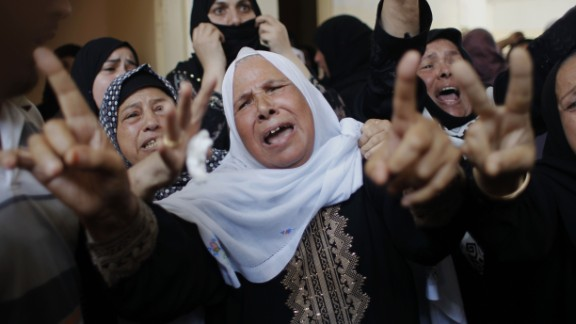 Palestinian female mourners grieve during the funeral of Mohammed al-Hamaida after he was killed in an Israeli air strike, on July 22, 2014.