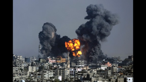 Smoke and fire from the explosion of an Israeli strike rise over Gaza City on July 22.