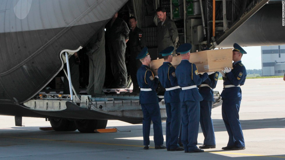 A Ukrainian honor guard loads a coffin onto a cargo plane at Kharkiv's airport on July 23.