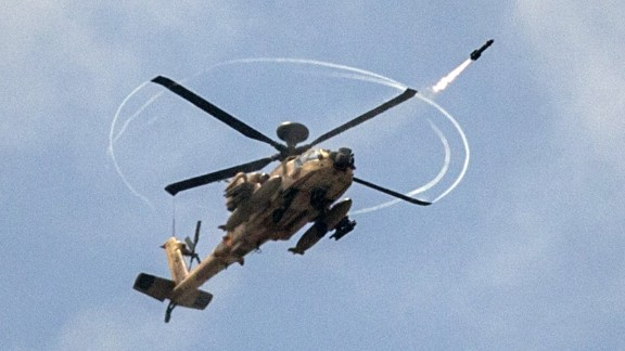 An Israeli Apache attack helicopter shoots a missile over the Gaza Strip on July 19, 2014.