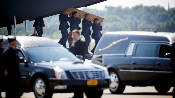 Military personnel carry a coffin holding the body of a victim of the crashed Malaysia Airlines Flight 17 out of a military transport plane during a ceremony to mark the return of bodies from Ukraine to the Eindhoven military air base in the Netherlands on Wednesday, July 23.