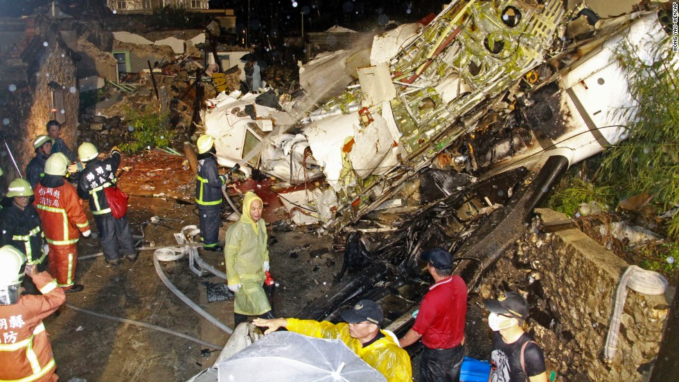 Rescuers work at the crash site on Wednesday, July 23. Flight GE222 was a twin-engine turboprop plane.