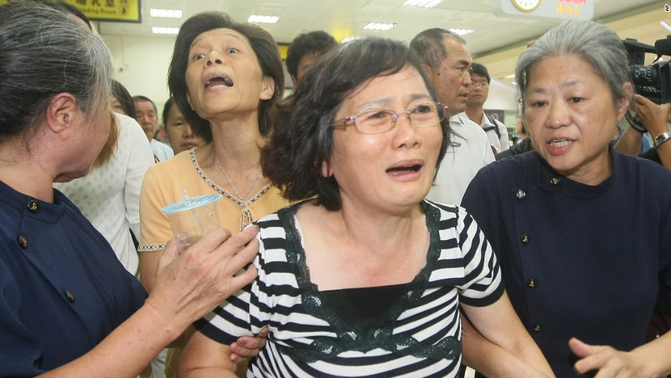 A passenger's relative reacts at the airport in Kaohsiung on July 23.