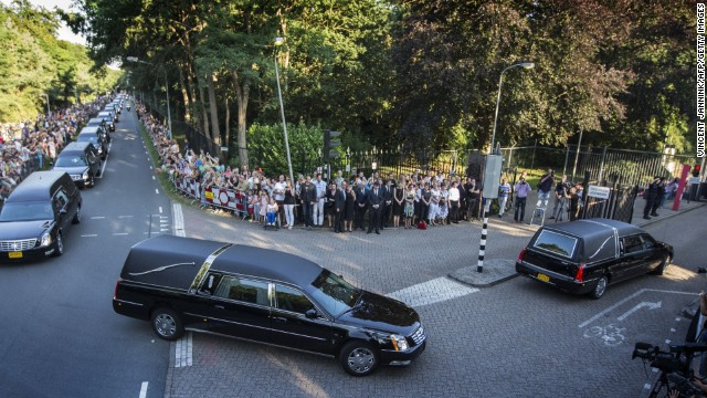 The convoy of hearses carrying coffins containing the remains of victims of the downed Malaysia Airlines flight MH17 arrives at the Korporaal van Oudheusden Kazerne in front a crowd of people lined up along the road, on July 23, 2014 in Hilversum, the Netherlands. The first bodies from flight MH17 arrived in the Netherlands today, almost a week after it was shot down over Ukraine, as the conflict flared yet again near the Malaysian airliner's crash site. AFP PHOTO / ANP / VINCENT JANNINK ** Netherlands Out ** (Photo credit should read VINCENT JANNINK/AFP/Getty Images)