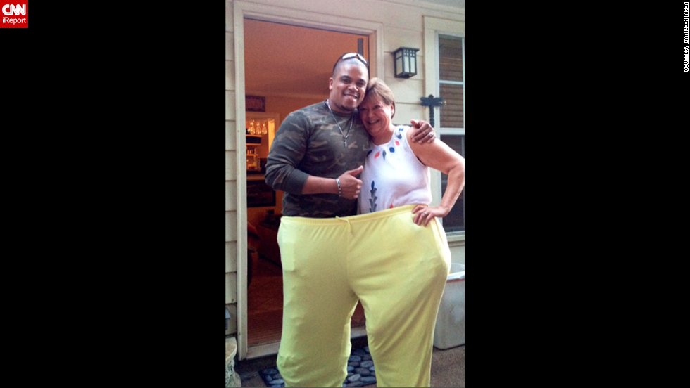 "At her ""200-pound"" weight-loss party, Riser tries on a pair of old pants -- large enough for her and personal trainer Shaun Lloyd."