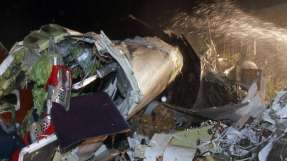 A photo taken on July 23, 2014 shows the wreckage of the TransAsia Airways flight GE222 after it crashed in Penghu islands. More than 40 people were feared dead in a plane crash in Taiwan with witnesses and local media reporting the flight came down in a storm after an aborted landing. Taiwan's transport minister said that 10 bodies had so far been recovered from the wreckage of the domestic flight, which had 58 people on board.