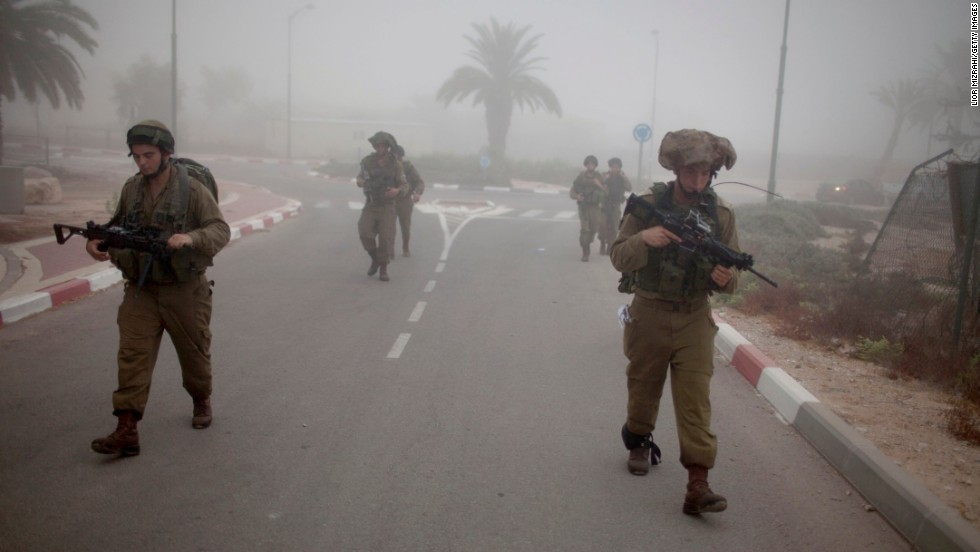 Israeli soldiers patrol the Israel-Gaza border on July 24.
