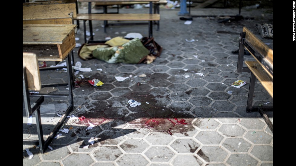 A trail of blood is seen in the courtyard of the school that was hit July 24 in the Beit Hanoun district of Gaza.