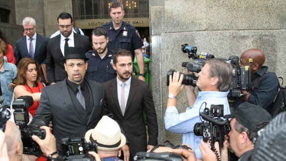 Shia LaBeouf, right, leaves criminal court on July 24, 2014, in New York City.