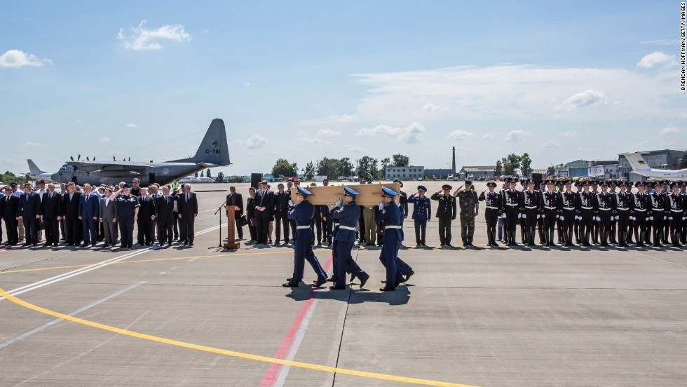 "A coffin containing a victim of Malaysia Airlines Flight 17 is loaded onto a plane in Kharkiv, Ukraine, on Wednesday, July 23. Many of the victims <a href=""http://www.cnn.com/2014/07/23/world/gallery/mh17-victims-bodies/index.html"">have been returned</a> to the Netherlands, where Flight 17 originated. Of the 298 people who died, 193 were Dutch citizens."