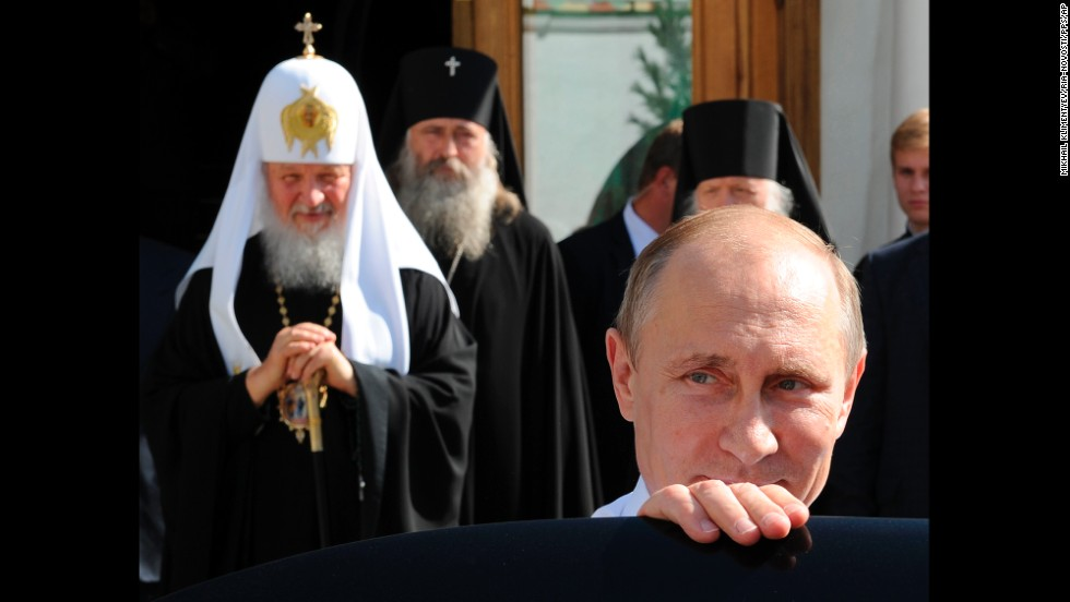 Russian President Vladimir Putin, front, leaves after meeting with Russian Orthodox Patriarch Kirill, left, on Friday, July 18, in Sergiyev Posad, Russia. Putin was attending celebrations for the 700th anniversary of St. Sergius of Radonezh.