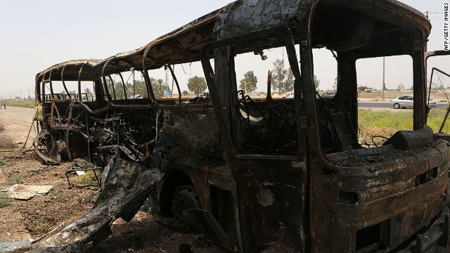 A picture taken on July 24, 2014, shows the remains of a bus that was transferring convicts from a prison north of Baghdad after it was attacked by suicide bombers and gunmen, in Taji, some 25 kilometres (15 miles) north of Baghdad. Security and medical officials said that around 50 prisoners were among the dead, many of them burnt beyond recognition. A number of policemen also died. AFP PHOTO/AHMAD AL-RUBAYEAHMAD AL-RUBAYE/AFP/Getty Images