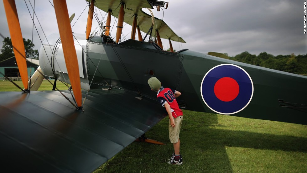 "Young aviation enthusiast Patrick Wilson looks at an Avro 504K in Biggleswade, England, on Monday, July 21. The World War I-era plane is part of the <a href=""http://www.shuttleworth.org/shuttleworth-collection/shuttleworth-collection.asp"" target=""_blank"">Shuttleworth Collection</a>, a museum known for its classic aircraft."